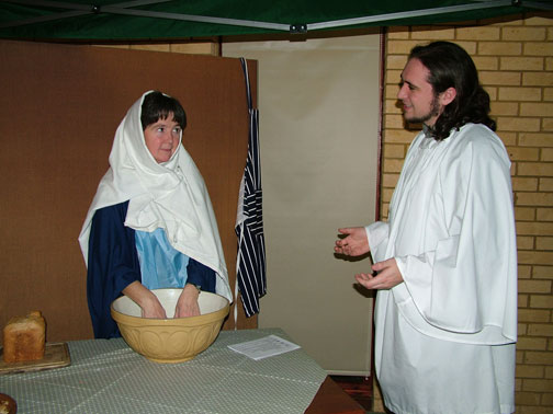 Mary, in her kitchen, is visited by Gabriel